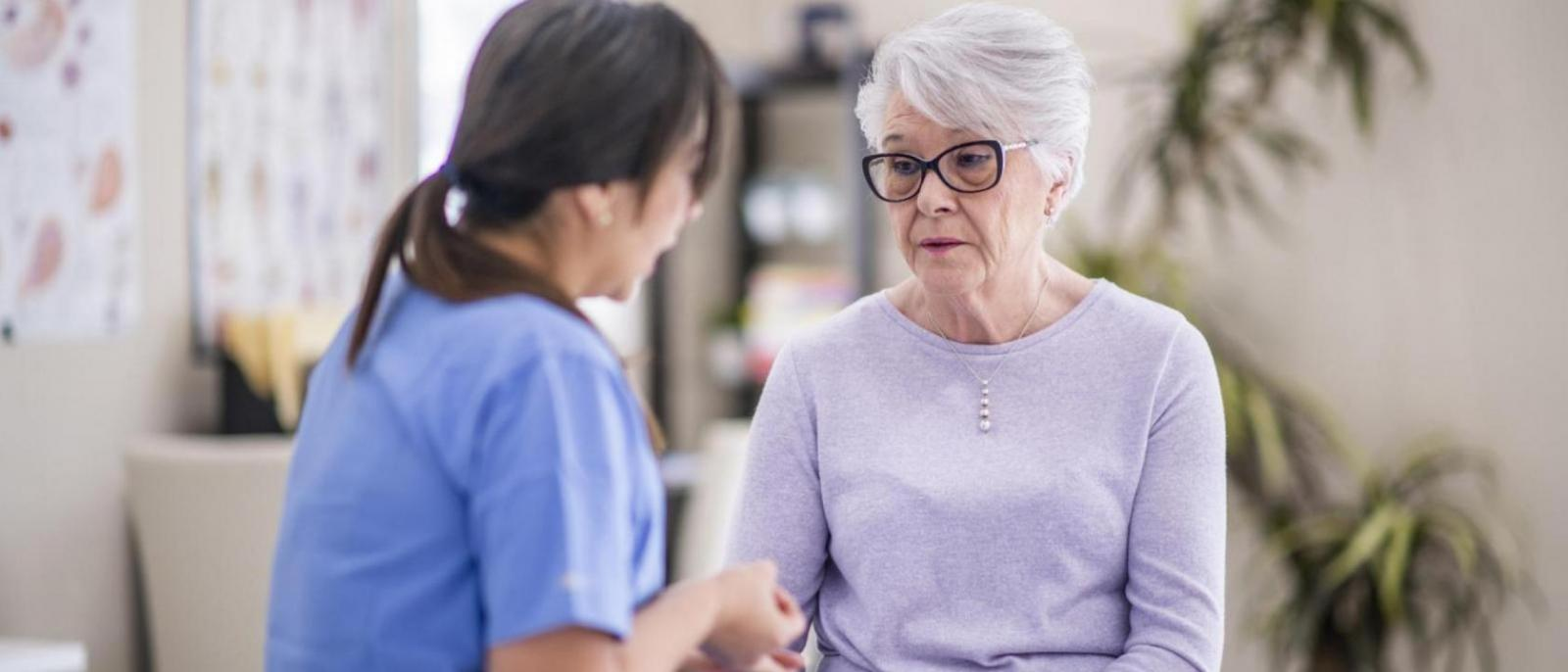 A senior woman talks to her doctor about some recent struggles she is going through.